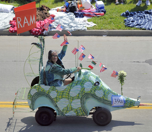 Writer Mark Hertzberg peddles the Reidster in the 2014 parade.